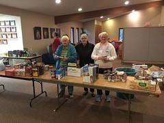 Emogene J., Ruth N. and Diane P. sorting food donations