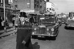 1970s funeral Hoxton east London Uk (Homer Sykes) Tags: uk england people london english walking person britain funeral tophat hoxton 70s british 1978 1970s hearse infront eastend eastlondon workingclass housingestate gbr greaterlondon archivestock