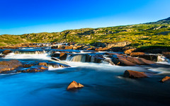 River in Hardangervidda - Norway (Existens) Tags: longexposure blue sky mountain mountains green nature water norway river landscape norge waterfall blurry nikon sunny gras hardanger elv waterflow hardangervidda hardangerfjord eidfjord hardangervidden d3100 nikond3100