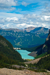 Lake Louise in the Summer (aitramah) Tags: travel lake canada mountains water vertical clouds bluesky alberta lakelouise verticallandscape verticalphotography verticalnature