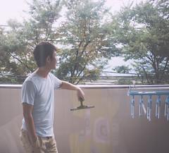 balcony/cleaning (Nazra Zahri) Tags: morning portrait man adam k japan standing asian outside japanese nikon raw balcony husband laundry nikkor washing okayama 28200mm 28200mmf3556g 2013 d700 vscofilm