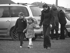 Untitled (Fire*Sprite*75) Tags: street family girls blackandwhite monochrome sisters walking strangers windy mum