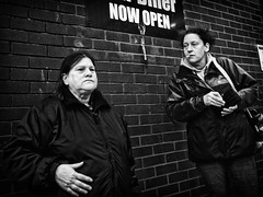 Wallflowers (Ross Magrath) Tags: from street camera uk autumn 2 portrait england bw white black cold colour face june contrast digital canon wonderful dark photography eos mono weird high funny noir shadows gloomy serious pentax mark no candid character north hats sunny backstreet lancashire m full v ii shade frame unknown 5d shooting cropped format imaging gloom gr agus piercings ban drama miserable et blackpool blanc ricoh sneaky compact sensor mkii cloaks informal dubh apsc