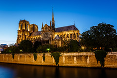 Notre Dame de Paris Cathedral and Seine River in the Evening, Paris, France (ansharphoto) Tags: city travel bridge blue vacation sky paris france building tower history church lamp electric seine skyline architecture night facade river french temple lights evening town twilight ancient europe european catholic cityscape view cathedral dusk basilica religion gothic culture landmark medieval quay illuminated christian belfry romantic notre dame embankment cite noter
