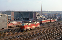 """Saalfeld - the view from the bridge by 63842 - Bw Saalfeld; lots of late afternoon action around the turntable, with a 232 taking a spin and several of the Romanian built 219's also in evidence, 31.10.92. The 219 in the foreground is 219132, with 232155 parked to the left outside the roundhouse.  This upload of scanned slides follows from one over a year ago, which has been substantially reworked and all are included in the set """"Saale Valley, Thuringia""""."""