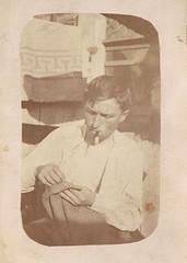 Self-Made-Man (TrueVintage) Tags: man sepia sewing smoking oldphoto mann 1910s past foundphoto 1917 rauchen vergangenheit vintagephoto nhen vintageman flawedphoto faddedphoto