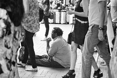 On the downtown mall. After a LOOK3 talk. (nataliekrovetz) Tags: people blackandwhite bw man prime homeless crowd streetphotography grainy society primelens canon85mm look3