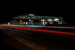 ... night time drive by ... (jane64pics) Tags: nighttimedriveby lights lighting night nightshoot nightphotography nightlights garage topaz topazgarage longexposure cars carlights lightanddark lighttrail greystonescameraclub gcc janefriel janefriel2016