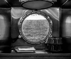 ship's galley porthole (-gregg-) Tags: cruise ship galley porthole bw ocean horizon chrome different