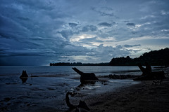 Rainy day on the beach (Mata Telinga) Tags: sarawak borneo rain beach blue dark sonya7rii