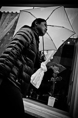 _DSC5013 (stimpsonjake) Tags: nikoncoolpixa 185mm streetphotography bucharest romania city candid blackandwhite bw monochrome umbrella face youngwoman
