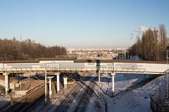 Moskvorechye Rail Station with Skyline (Wholesale of Void) Tags: moscow moscowcity november winter daylight sunlight clearsky road bridge skyine cityscape railroad saburovo urban street saburovodistrict moskvorechyesaburovodistrict