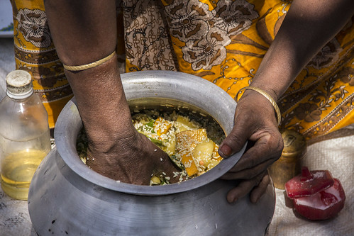A woman preparing a nutritious lunch in Rangpur, Bangladesh. Photo by Holly Holmes, 2013.