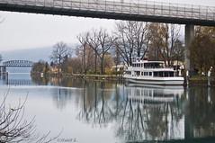 (Mad Physics Guy with a Camera) Tags: bridge autumn trees winter lake reflection fall water river schweiz switzerland boat nikon europe suisse svizzera interlaken svizra nikond5000