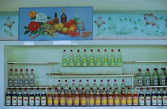 Shop drink display (Frhtau) Tags: people food shop price painting asian asia bottles drink farm side country north decoration culture korea du laden east advertisement stuff agriculture regal nord ware cooperative dprk getrnke waren kore