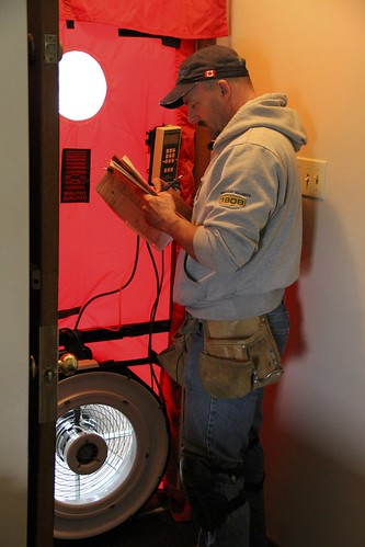 Energy auditor Rob Gawreletz conducts the blower test to reveal how often the air exchanges occur in a home - this 55-year-old bungalow is getting 3.87 air exchanges per hour, a little higher than average and much higher than the preferred rate of one exc