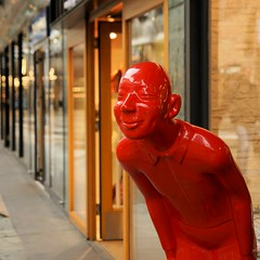 Friendly Welcome (Hindrik S) Tags: pop red read rood man dummy model shop koopgoot rotterdam square 180 f28 iso125 50mm tamron tamronspaf1750mmf28xrdiiildasphericalif tamron1750 1750 kkec sonyphotographing amount