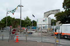 Bridge of Remembrance under Repair (Jocey K) Tags: road street bridge trees newzealand christchurch signs building sign architecture flag peoples vans roadcones bridgeofremembrance cashelstreet shippingcontainters bridgeofremembranceeqrepairs tramelines