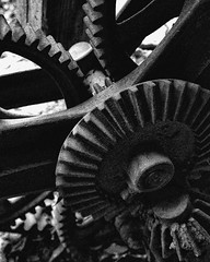 Gears (Samantha Evans of Samantha Evans Photography) Tags: blackandwhite bw stilllife sun sunlight white black history lines wheel metal canon ga tooth circle georgia rust grain machine gear line nik grainy cog westville repeatingpatterns lumpkin livinghistorymuseum repeatingpattern tamron1750 canon60d lumpkinga niksilverefex2