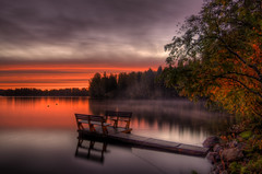 Silence in the lake (MilaMai) Tags: morning autumn red mist lake reflection tree fall beach nature water beautiful leaves birds misty fog clouds forest sunrise suomi finland countryside wooden dock chair rocks europe silent foggy dramatic hdr waterscape mntyharju milamai vision:mountain=0572 vision:sunset=0726 vision:sky=099 vision:ocean=0608 vision:clouds=093 vision:outdoor=072