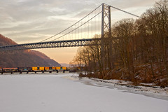 Rolling Off Into the Sunset - in explore (SunnyDazzled) Tags: railroad bridge winter snow newyork ice creek train river fort bearmountain hudson montgomery freight trainbridge popolopen vision:text=0524 vision:sunset=0569 vision:outdoor=077 vision:car=0633
