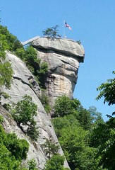 Chimney Rock (Francine Schumpert) Tags: trees mountains nature rock landscape northcarolina sunny americanflag fair americathebeautiful clearskies chimneyrocknc chimneyrockstatepark