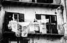 Vento di scirocco (encantadissima) Tags: portoempedocle agrigento vicolo balcone panni nonnina monocromo bienne streetphotography