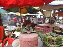 Food stall holder working under the shade of an Umbrella - Crab Market Kep Cambodia (WanderingPhotosPJB) Tags: umbrella cambodia kep crabmarket market bazaar food