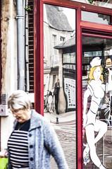 Hours - Women & street photography (Chris Rod Photo) Tags: chrisrodphoto 2016 bayeux normandie reflet reflection velo bike women feminism marinire cadre rouge devanture magasin street rue streetphotography photographiederue composition triptyque urbain uran window glace miroir
