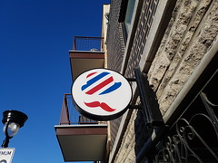 Barbershop Sign (Exile on Ontario St) Tags: barbershop barbier montral barber mecs cheveux hair salon coiffeur shop business petite patrie sign affiche enseigne beaubien signe pignon circle rond cercle chapeau pole barberpole bleu lesmecscheveux mecscheveux rouge red blue hat mustache moustache facial petitepatrie lapetitepatrie montreal facialhair balconies balcon sky hairsalon balcons ciel balcony clear day