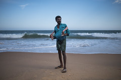Fisherman (Ravikanth K) Tags: 500px fisherman shell collector beach sand sea manapad water sigma 35mm art portrait people travel tamilnadu india outdoor relaxed mood blue waves casual