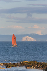 The Reaper  sailing by Bass Rock (Christopher Combe Photography) Tags: sunset sea sky water clouds evening scotland boat rocks sailing ship fife maritime sail