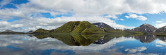 Reflections in a lake in Landmannalaugar, Iceland (Miche & Jon Rousell) Tags: blue panorama mountain lake reflection rock clouds iceland pano getty gettyimages landmannalaugar frameit rhyolitic betterthangood absolutelystunningscapes fjallabaknaturereserve