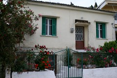 Greek House (late2lense) Tags: door flowers windows roses garden gate greece shutters geranium railings flowerpots corrogatedroof