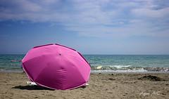 La Sombrilla Rosa (Agus MC) Tags: pink sea summer espaa sol beach umbrella mar spain sand holidays rosa playa arena murcia verano sombrilla vacaciones mazarrn