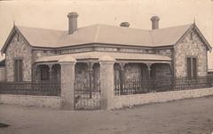 Unidentified house with Adelaide bluestone walls (c.1910) (pellethepoet) Tags: photograph postcard realphotopostcard rppc architecture southaustralia australia house kodak adelaide adelaidebluestone algarra austral