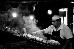 Parrillero (TheWanderingAmerican) Tags: street portrait blackandwhite bw white black puerto uruguay blackwhite beef cook streetphotography bbq meat grill mercado chef barbecue parrilla montevideo asado churrasco mercadodelpuerto