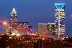 charlotte city skyline at night (AgFineArtPhotography.com) Tags: copyright streets architecture modern buildings lights evening action trails busy metropolis copyrighted 2013 charlottecity skylineatnight