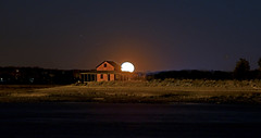 Moonrise behind the Shack (Bob Gundersen) Tags: ocean park old longexposure red sea orange usa moon house black building abandoned beach water yellow architecture night barn port marina dark landscape outside island coast harbor photo seaside interesting sand nikon flickr exterior waterfront image shots connecticut sandy country shoreline picture newengland ct places scene clear anchorage madison shore shanty historical moonlight nightshots shack jacobs scenes gundersen longislandsound guilford conn whitfieldstreet towndock nikoncamera d600 lisound jacobsbeach grassisland nikond600 glct connecticutscenes guilfordlandconservationtrust bobgundersen grassislandshack robertgundersen