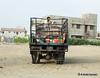 smart phone (khalidhameed0110) Tags: street pakistan urban man phone fujifilm karachi texting truch x100s