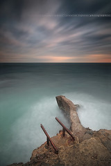 Surfing With The Alien ... Cap D'Antibes, Alpes-Maritimes - France (Yannick Lefevre) Tags: longexposure sunset seascape france stone photoshop landscape pier nikon cotedazur raw nef tripod wideangle paca provence paysage dri manfrotto hoya capdantibes frenchriviera d300 alpesmaritimes ndfilter nd400 sigma1020 poselongue nikoncapturenx ndx400 capturenx2 chemindescontrebandiers yllogo yannicklefevre||photography