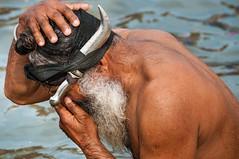 During Kumbh Mela pilgrimage 2013, Allahabad, India (David Ducoin) Tags: portrait india water river beard bath asia religion knife ritual turban sikh pilgrimage pilgrim ganga mela allahabad purification kumbhmela kumbh 2013
