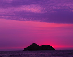 Asia's Dawn II (lbp_3) Tags: pink sunset sea summer orange brown sun color colour beach peru rock clouds canon island dawn mar reflex rojo asia waves lima south t3 olas revel