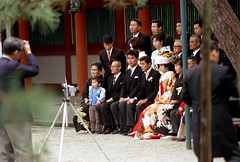 20-741 (ndpa / s. lundeen, archivist) Tags: camera family people color building men film japan 35mm japanese groom bride clothing women kyoto shrine photographer traditional tripod nick families tie clothes suit tuxedo weddingparty 20 1970s shinto 1972 tux shintoshrine weddingphotos weddingpicture weddingphoto dewolf honshu heianshrine  familymembers grouphoto nickdewolf photographbynickdewolf reel20