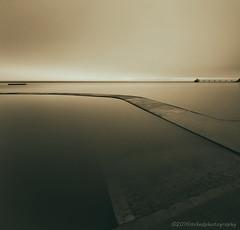 The Curve (modulationmike) Tags: sea lake subtle nikon long exposure sky mood tonal pier coastal
