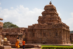 The era of the mobile phone camera tourist (Scalino) Tags: india karnataka travel trip pattadakal heritage site chalukyas chalukya sari orange mobile phone carmera tourist indian snap temple hindu