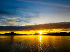 Sunrise off the Norwegian Coast (MoonDog (Life is Beautiful)) Tags: sun sunrise sea coast coastline clouds orange