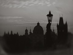 Spires -Petzval Lens (Firery Broome) Tags: architecture landscape cityscape towers spires lamppost sky clouds morninglight earlymorning autumnsunrise prague charlesbridge historic historicplaces historicicons europe europe2014 skyscape skyline silhouette olympus em10 olympusem10 photoshop viveza alienskin exposurex2 monochrome blackandwhite blackwhite bw blackandwhitelandscape browntone petzvallens daguerreotypeprocess 365 czechrepublic