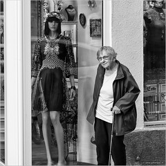 When I was young... (John Riper) Tags: johnriper street photography straatfotografie square vierkant bw black white zwartwit mono monochrome hungary budapest candid john riper fujifilm fuji xt1 18135 old lady woman fashion dummy window reflections cane