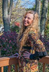A Perfect Match (tquist24) Tags: goshen hww indiana nikon nikond5300 outdoor wanda autumn curls fall fence girl hair portrait pretty smile tree trees woman